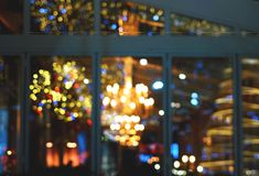 Christmas lights in the window at night.  royalty free stock photo
