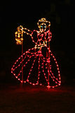 Christmas Lights Woman. Christmas lights in the shape of an old fashion lady & lantern Royalty Free Stock Photography