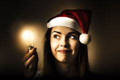 Christmas lights woman with bright idea Stock Photo