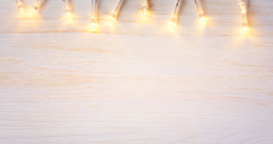 Christmas lights on wood background. stock images