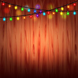 Christmas lights on wood background Royalty Free Stock Photography