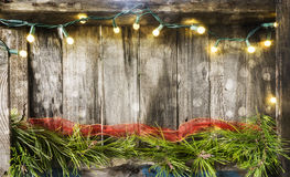Christmas lights on vintage wood Stock Photos