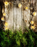 Christmas lights on vintage wood Royalty Free Stock Images