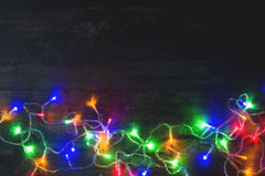 Christmas lights. On a wood table royalty free stock photo