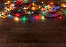 Christmas lights on wood texture with place for text royalty free stock photo
