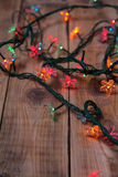 Christmas lights on a wooden background Stock Image