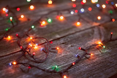 Christmas lights on a wooden background. Royalty Free Stock Photography