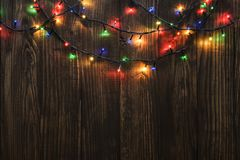 Christmas lights on wooden background Royalty Free Stock Photography