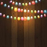 Christmas Lights On Wooden Background Colourful Stock Images