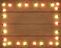 Christmas lights on wooden background, frame with. Garlands, horizontal wallpaper Royalty Free Stock Photos