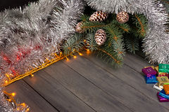Christmas lights on a wooden background with free space. Frame with silver christmas chain. Stock Photography