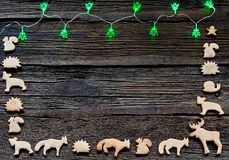 Christmas lights on a wooden background with free space. Gingerbread in the shape of animals, stars and hearts Stock Photography