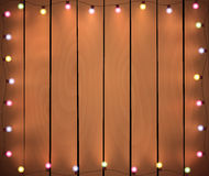 Christmas lights on wooden background Royalty Free Stock Photo
