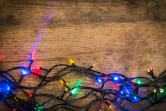 Christmas lights on wooden background Stock Image