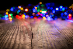 Christmas lights on wooden background Stock Photography
