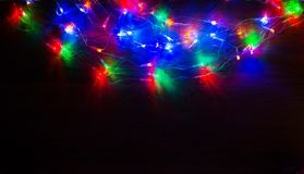 Christmas lights on wooden background Royalty Free Stock Images