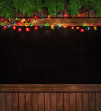 Christmas lights on wooden blackboard Stock Photography