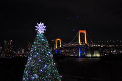 Christmas lightup at Tokyo Bay. A beautifully lit up Christmas Tree and the view of the rainbow bridge, Tokyo Bay, Japan stock images