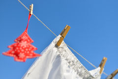 Christmas on line - Christmas tree on a clothesline Royalty Free Stock Photography