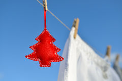 Christmas on line - Christmas tree on a clothesline Stock Photography