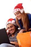 Christmas on-line shopping. Young couple girl in Christmas on-line shopping on white background Royalty Free Stock Photo