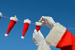 Christmas on line - XXXXS Santa Hats Stock Photos