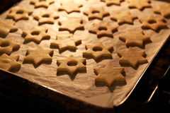 Christmas Linzer cookies in the oven Stock Image
