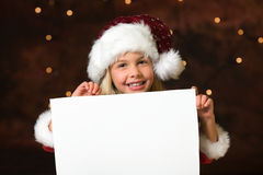 Christmas list of wishes. Little miss santa with a empty list of wishes royalty free stock photo