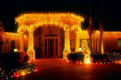 Christmas Lit Entry - Night. Upscale house entry way decorated for Christmas, shot at night, exposed for lights, dark background Royalty Free Stock Photos