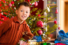 Christmas - little boy with Xmas present Stock Photography
