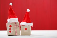 Christmas little gift boxes with Santa hats Royalty Free Stock Photography