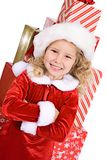 Christmas: Little Girl In Front Of Large Stack Of Wrapped Gifts stock images