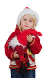 Christmas little girl with Santa hat and little Santa toy Royalty Free Stock Image