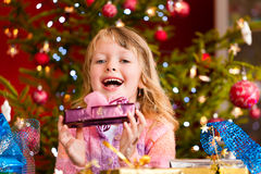 Christmas - little girl with Xmas present Royalty Free Stock Photography