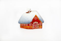 Christmas little glass house with snow covered roof. Christmas little orange glass house with snow covered roof. christmas decoration. isolated on white Stock Photo