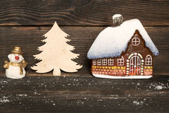 Christmas little glass house with snow covered roof, Snowman and royalty free stock photos