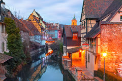Christmas Little Venice in Colmar, Alsace, France. Traditional Alsatian half-timbered houses, church and river Lauch in Petite Venise or little Venice, old town Royalty Free Stock Photos