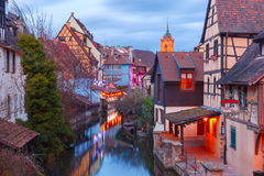 Christmas Little Venice in Colmar, Alsace, France. Traditional Alsatian half-timbered houses, church and river Lauch in Petite Venise or little Venice, old town Royalty Free Stock Photography