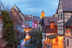Christmas Little Venice in Colmar, Alsace, France. Traditional Alsatian half-timbered houses, church and river Lauch in Petite Venise or little Venice, old town Stock Photos