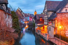 Christmas Little Venice in Colmar, Alsace, France. Traditional Alsatian half-timbered houses, church and river Lauch in Petite Venise or little Venice, old town Stock Photography