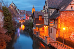 Christmas Little Venice in Colmar, Alsace, France. Traditional Alsatian half-timbered houses, church and river Lauch in Petite Venise or little Venice, old town Stock Image