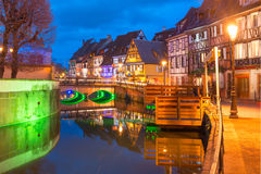 Christmas Little Venice in Colmar, Alsace, France. Traditional Alsatian half-timbered houses in Petite Venise or little Venice, old town of Colmar, decorated and Stock Photo