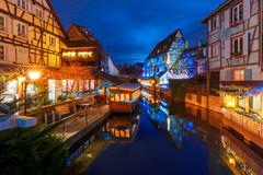 Christmas Little Venice in Colmar, Alsace, France. Traditional Alsatian half-timbered houses and river Lauch in Petite Venise or little Venice, old town of Stock Photos