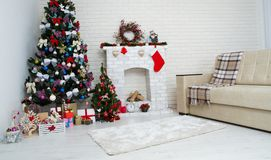 Christmas living room with a christmas tree and presents under it - modern classic style, new year concept royalty free stock image