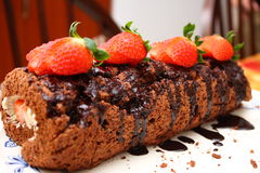 Christmas Log Cake. With strawberry stock images