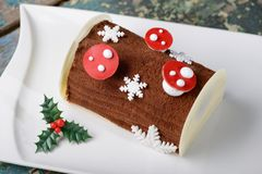 Christmas log chocolate cake (Lime mix berry) Royalty Free Stock Photos