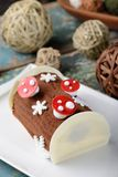 Christmas log chocolate cake (Lime mix berry) Stock Photos