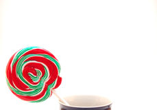 Christmas Lollipop in a Cup. A bright Christmas lollipop standing alone in a cup on a white background Stock Photography