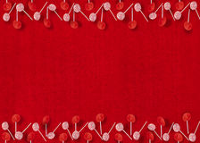 Christmas Lollipop Ornaments on Red Textured Background Royalty Free Stock Images