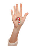 Christmas lollipop painted on kid's hand Royalty Free Stock Image
